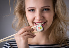 Young woman holding sushi rolls Royalty Free Stock Images