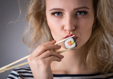 Young woman holding sushi rolls Royalty Free Stock Photos