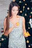 Young woman holding sweet mandarin, orange mood, diet and New year concept stock photography