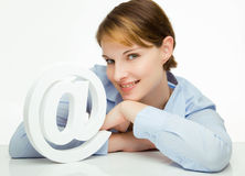 Young woman holding an @ symbol Royalty Free Stock Photos