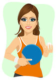 Young woman holding table tennis racket and ball. Portrait of young woman holding table tennis racket and ball Stock Photography