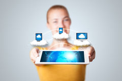 Young woman holding tablet with modern devices Stock Images