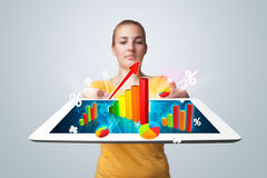 Young woman holding tablet with colorful graphs and diagrams Royalty Free Stock Images