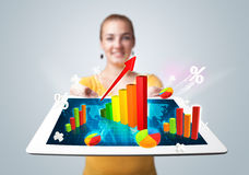 Young woman holding tablet with colorful graphs and diagrams Stock Images