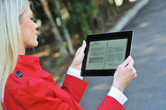 Young woman holding tablet computer in hands Royalty Free Stock Photo