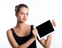 Young woman holding a tablet computer over white background Stock Image