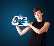 Young woman holding tablet with modern devices in clouds Royalty Free Stock Photo