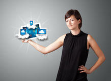 Young woman holding tablet with modern devices in clouds Stock Photos