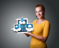 Young woman holding tablet with modern devices in clouds. Beautiful young woman holding tablet with modern devices in clouds Stock Photography