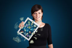 Young woman holding tablet with money Stock Photos