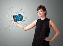 Young woman holding tablet with money Stock Photography