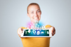 Young woman holding tablet with numbers Royalty Free Stock Photo