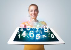 Young woman holding tablet with numbers Royalty Free Stock Photography