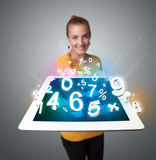 Young woman holding tablet with numbers Stock Photo