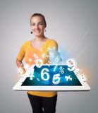 Young woman holding tablet with numbers Stock Image