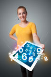 Young woman holding tablet with numbers Royalty Free Stock Photos