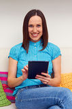 Young woman holding tablet pc Stock Image