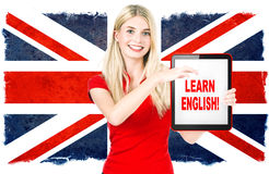 Young woman holding tablet pc. english learning concept royalty free stock photo