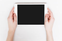 Young woman holding tablet. Pc. White table background royalty free stock image