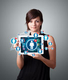 Young woman holding tablet with social network icons Royalty Free Stock Photo