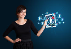 Young woman holding tablet with social network icons Royalty Free Stock Image