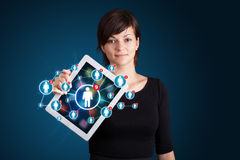 Young woman holding tablet with social network icons Stock Image
