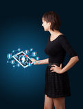 Young woman holding tablet with social network icons Stock Photo