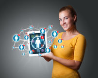 Young woman holding tablet with social network icons Royalty Free Stock Images
