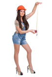 Young woman holding tape measure Stock Photography