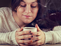 Young Woman holding a tea cup Stock Photo