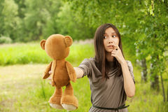 Young woman holding teddy bear Royalty Free Stock Photos