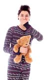 Young woman holding teddy bear with hand over her mouth Royalty Free Stock Image