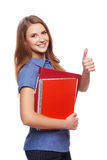 Young woman holding textbooks Royalty Free Stock Images