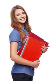 Young woman holding textbooks Stock Photography