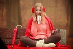 Young woman holding thermal mug. stock photography