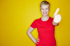 Young woman holding thumbs up Royalty Free Stock Photography