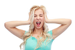 Young woman holding to her head and screaming Royalty Free Stock Photography