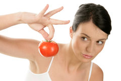 Young woman holding tomato Stock Photo