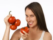 Young woman holding tomatoes Royalty Free Stock Photo