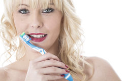 Young Woman Holding Tooth Brush Brushing Teeth. Attractive Young Woman Holding Tooth Brush Brushing Teeth Royalty Free Stock Images