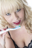 Young Woman Holding Tooth Brush Brushing Teeth Stock Photo