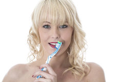 Young Woman Holding Tooth Brushing Teeth Royalty Free Stock Image