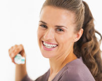 Young woman holding toothbrush with toothpaste Stock Image