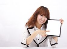 Young woman holding a touch pad Royalty Free Stock Image