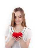 Young woman holding toy heart Royalty Free Stock Photos