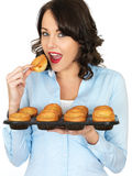 Young Woman Holding a Tray of Yorkshire Puddings Stock Photos