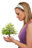 Young woman holding a tree Royalty Free Stock Photos