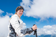 Young woman holding trekking pole in her hand Stock Images
