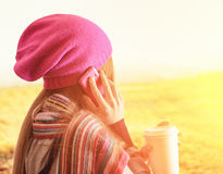 Young woman holding a tumbler of coffee. Outdoor portrait royalty free stock images