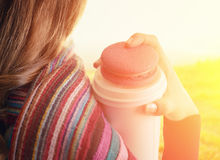 Young woman holding a tumbler of coffee. Outdoor portrait Royalty Free Stock Photography